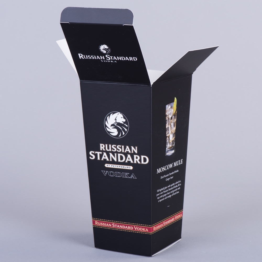 Shaped tuck in end carton