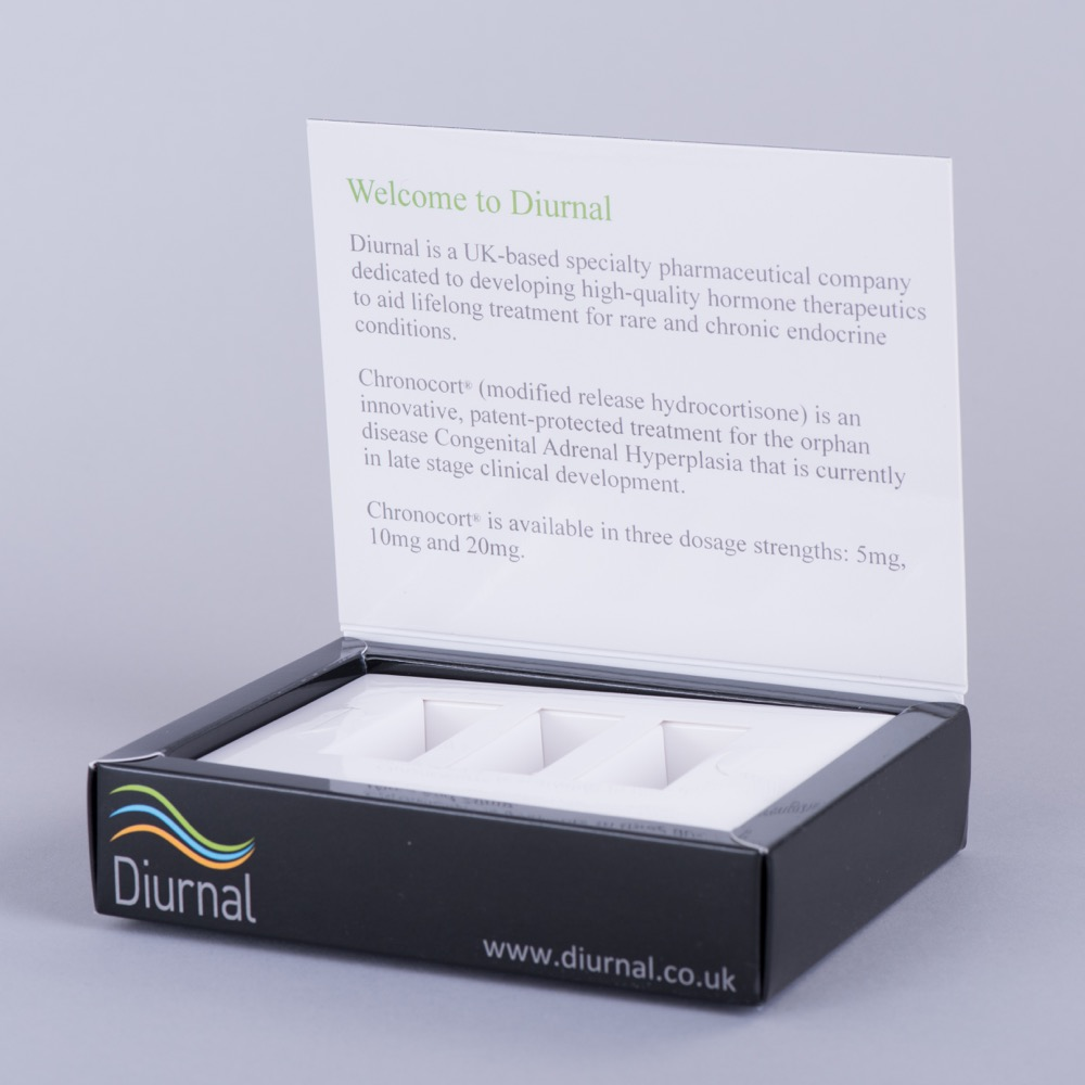 Hinged lid box promotional box with board fitment holding vials